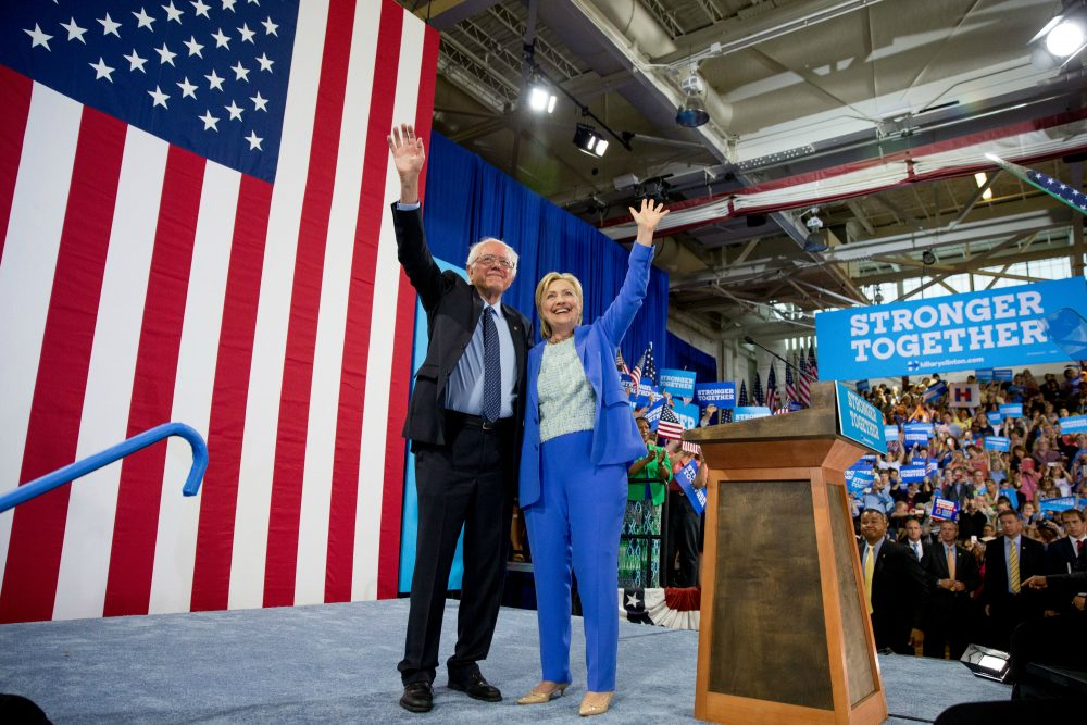 Bernie Sanders has endorsed Hillary Clinton. Renee Graham says that his supporters, as testy and heartbroken as they may now be, need to do the same. Pictured: Democratic presidential candidate Hillary Clinton and Sen. Bernie Sanders, I-Vt., wave to supporters as Sanders endorses Clinton during a rally in Portsmouth, N.H., Tuesday, July 12, 2016. (Andrew Harnik/AP)