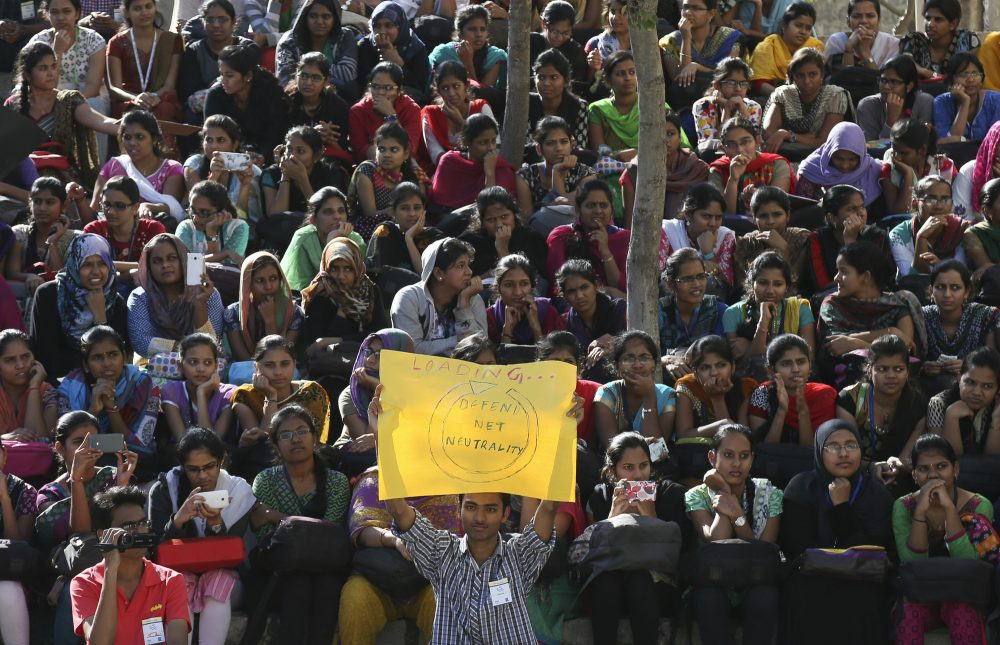 "Indian students gather for a protest against Facebook's ""Free Basics"" in Hyderabad, India, in December, 2015. Facebook CEO Mark Zuckerberg boasts that his 4-year-old effort to connect the developing world to the Internet has reached millions of people in some of the world's poorest nations, but Indian regulators banned one of the pillars of the campaign, a service known as Free Basics, because it provided access only to certain pre-approved services - including Facebook - rather than the full Internet. (Mahesh Kumar/AP)"