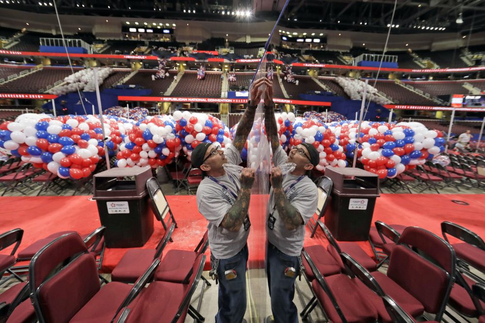 Wesley Baesel, from Cleveland, removes the protective coating from a mirror covered camera stand, as preparations are made for the Republican National Convention  at the Quicken Loans Arena in Cleveland, Ohio. (Alex Brandon/AP)