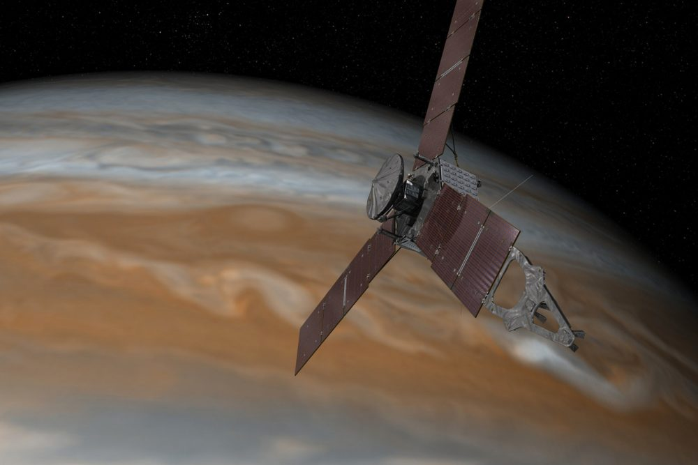 This artist's rendering made available by NASA/JPL-Caltech shows the Juno spacecraft above Jupiter. (NASA and JPL-Caltech/AP)