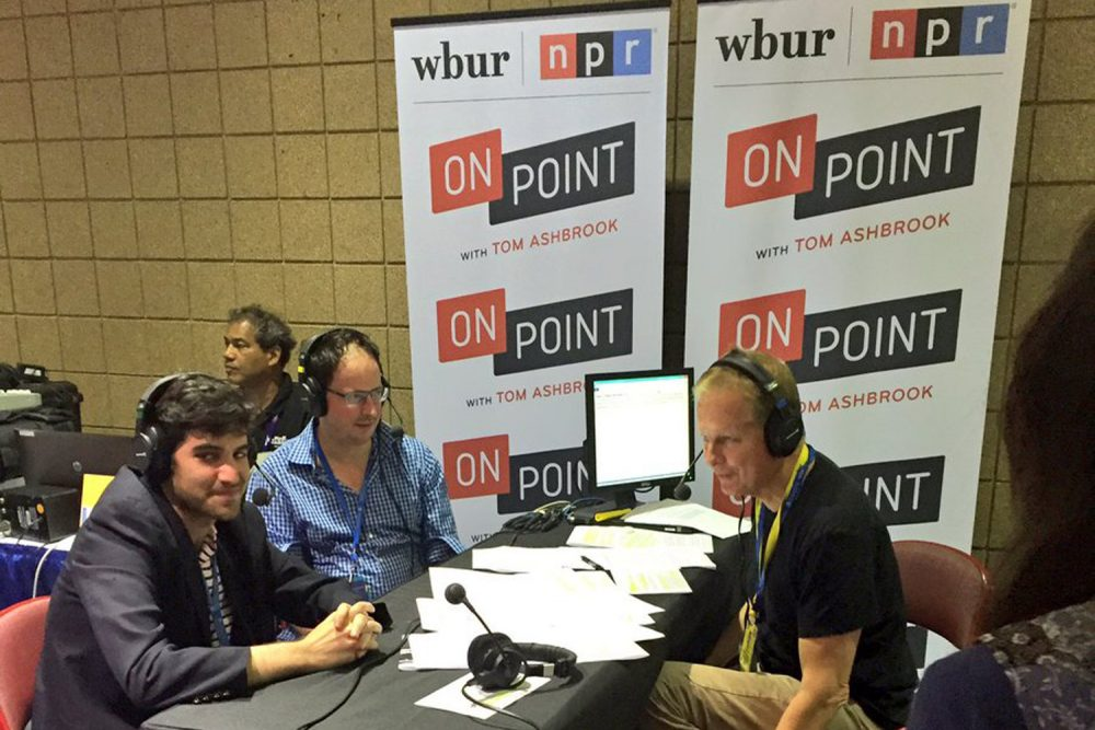 Host Tom Ashbrook is joined by FiveThirtyEight's Harry Enten (Left) and Nate Silver (right) at the 2016 Democratic National Convention in Philadelphia. (Abbie Ruzicka/WBUR)