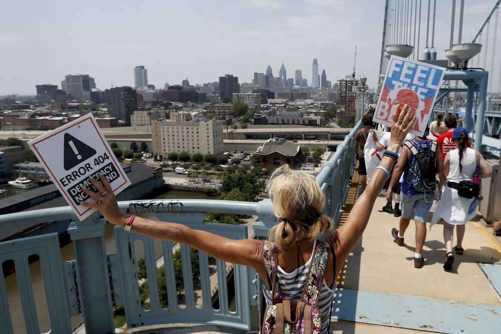 Demonstrators make their way to downtown on the Benjamin Franklin Bridge on Monday in Philadelphia, during the first day of the Democratic National Convention. (Alex Brandon/AP)