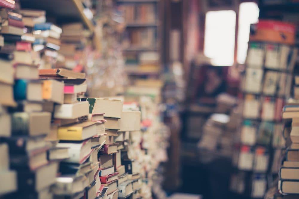 Stacks of books waiting to be read. (Eli Samuelu/Unsplash)