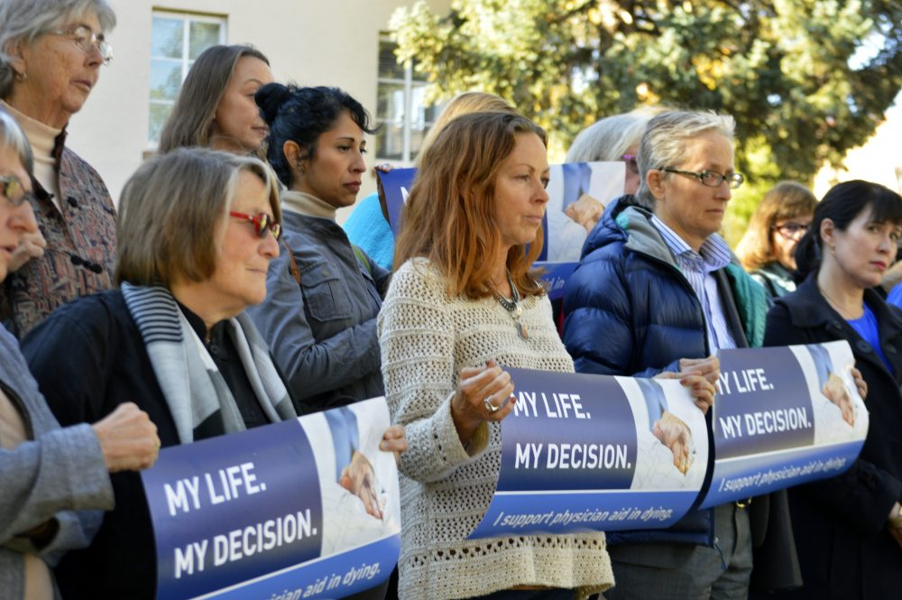 In this Oct. 26, 2015, file photo, right to die advocates rally outside the New Mexico Supreme Court in Santa Fe, N.M., after a lawyer asked justices to allow terminally ill patients to end their lives. (Russell Contreras/AP)