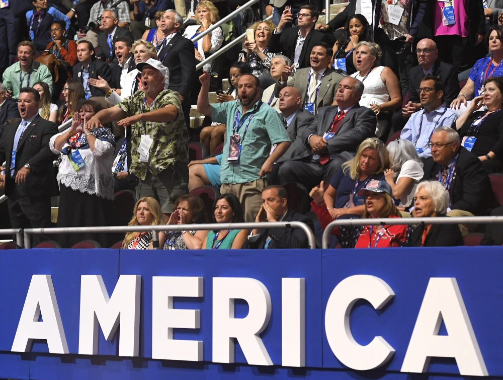 Attendees shout as Texas Sen. Ted Cruz delivers his speech at the Republican National Convention in Cleveland on Wednesday. He was booed once it became clear that he wasn't not going to endorse Republican presidential candidate Donald Trump. (Mark J. Terrill/AP)