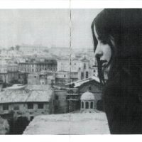 "The author's friend, Elizabeth ""Mopsy"" Matthews, looks out over the rooftops of Rome in 1969. (Courtesy)"