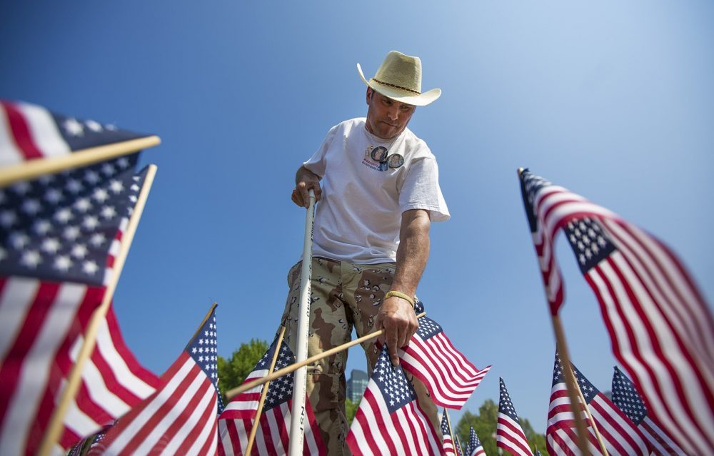 Carlos Arredondo planted flags on the Boston Common ahead of Memorial Day earlier this year. His son Alexander Arredondo was killed in Iraq in 2004. (Jesse Costa/WBUR)