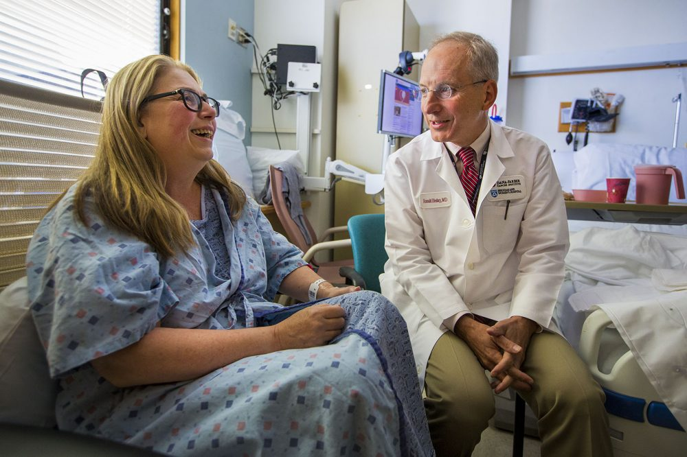 Julie Waldman and her physician, Dr. Ronald Bleday, discuss what to expect during her recovery from colon surgery, at Boston's Brigham and Women's Hospital. (Jesse Costa/WBUR)