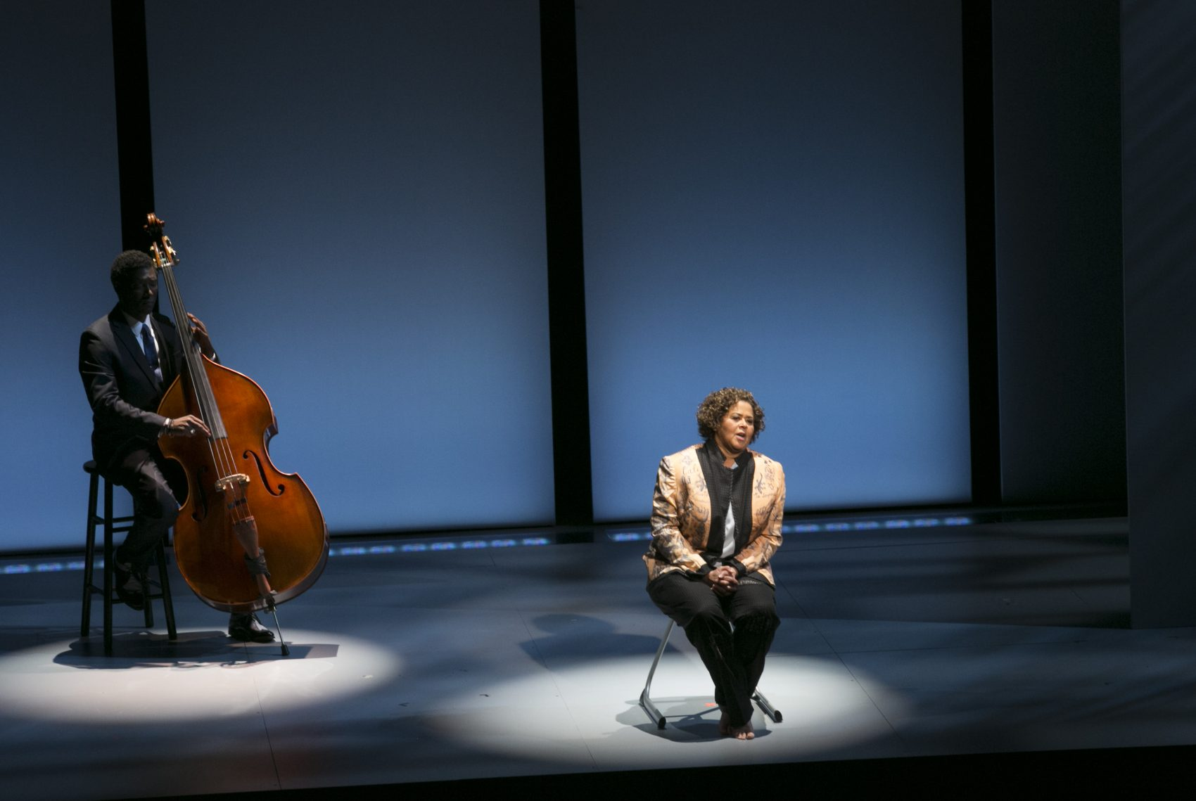 """Marcus Shelby (left) accompanies Anna Deavere Smith in """"Notes from the Field: Doing Time in Education"""" at the American Repertory Theater in Cambridge, Massachusetts. (Courtesy Evgenia Eliseeva/A.R.T.)"""