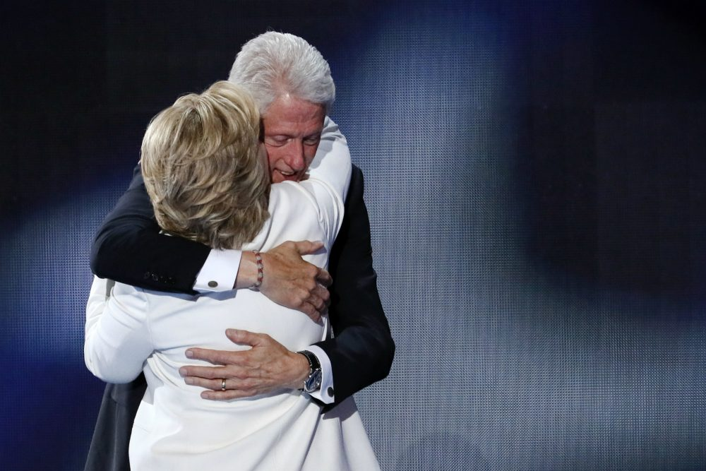 Former President Bill Clinton hugs his wife Democratic presidential nominee Hillary Clinton during the final day of the Democratic National Convention in Philadelphia , Thursday, July 28, 2016. (J. Scott Applewhite/AP)