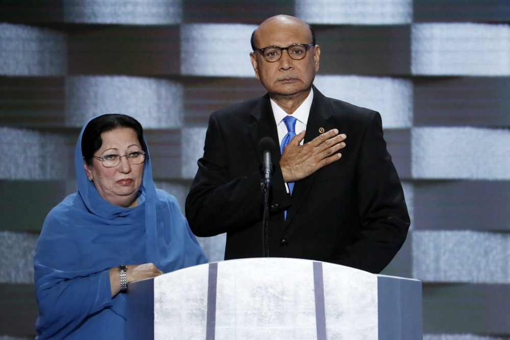 In this Thursday, July 28, 2016 file photo, Khizr Khan, father of fallen US Army Capt. Humayun S. M. Khan and his wife Ghazala speak during the final day of the Democratic National Convention in Philadelphia. Republican presidential nominee Donald Trump broke a major American political and societal taboo over the weekend when he engaged in an emotionally-charged feud with Khizr and Ghazala Khan, the bereaved parents of a decorated Muslim Army captain killed by a suicide bomber in Iraq. He further stoked outrage by implying Ghazala Khan did not speak while standing alongside her husband at last week's Democratic convention because they are Muslim. (J. Scott Applewhite/AP)