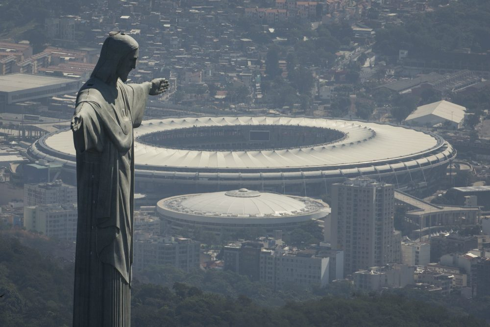 The Christ the Redeemer statue stands above Maracana stadium in Rio de Janeiro, Brazil, Monday, Aug. 1, 2016. The Summer Olympics start Aug. 5. (Felipe Dana/AP)