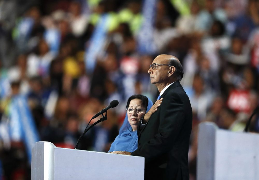 Ghazala and Khizr Khan Khan, parents of fallen U.S. Army Capt. Humayun S. M. Khan, take the stage on the final day of the Democratic National Convention in Philadelphia, July 28, 2016. (Paul Sancya/AP)