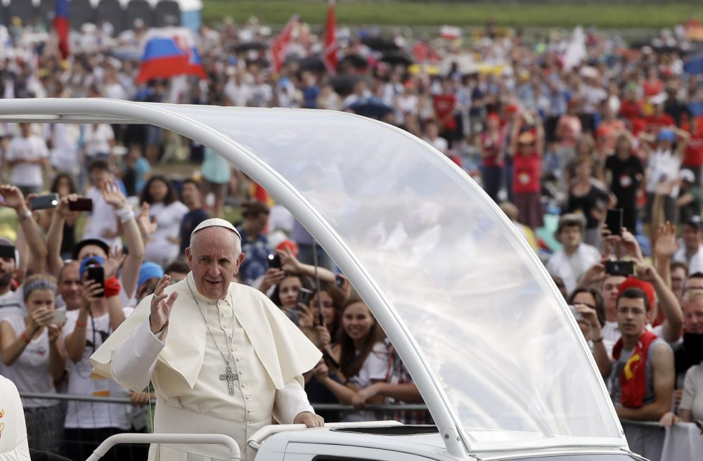 Pope Francis followed by a security guard arrives to celebrate a mass at conclusion of the World Youth Day in Krakow, Poland on July 31. (Gregorio Borgia/AP)
