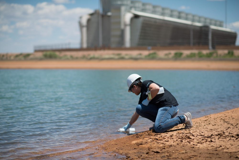 Arizona State University research technician Mary Cuevas tests water at Coronado Generating Station in St. Johns, Arizona. (Courtesy of Patty Garcia-Likens/SRP)