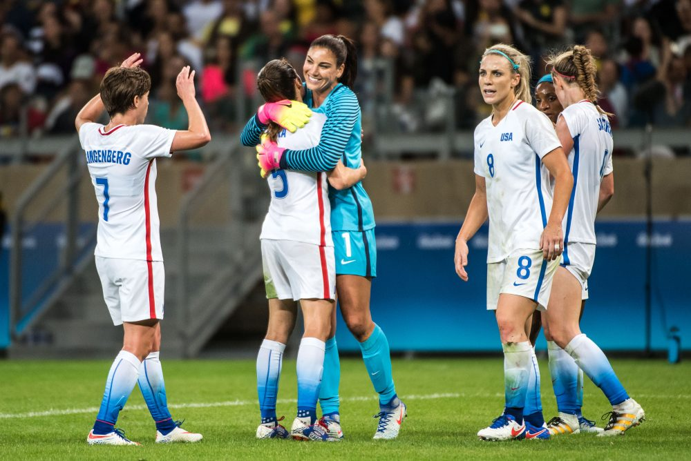 USA players celebrate after the Rio 2016 Olympic Games first round Group G women's football match United States vs New Zealand at the Mineirao stadium in Belo Horizonte, Brazil on Aug. 3, 2016. (Gustavo Andrade/AFP/Getty Images)