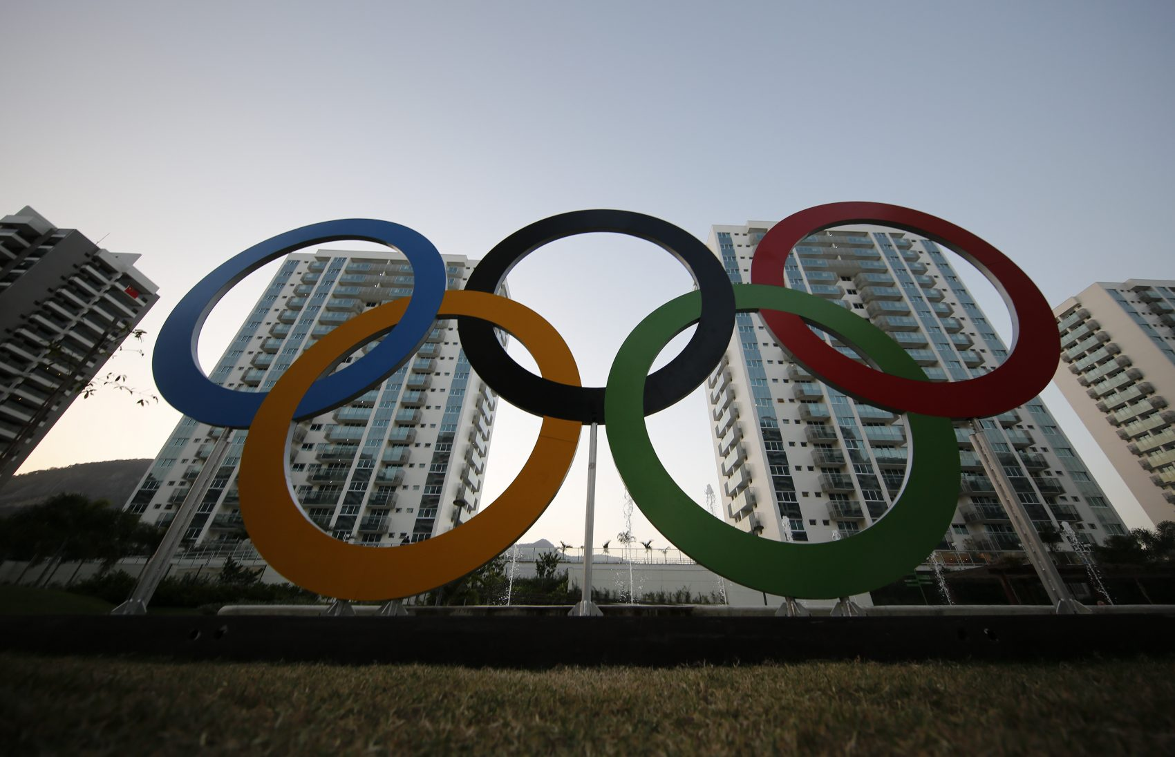 The Olympic rings in front of the Olympic Village in Rio de Janeiro, Brazil. The brand new complex of residential towers are where nearly 11,000 athletes and some 6,000 coaches and other handlers will sleep, eat and train during the games. (Leo Correa/AP)