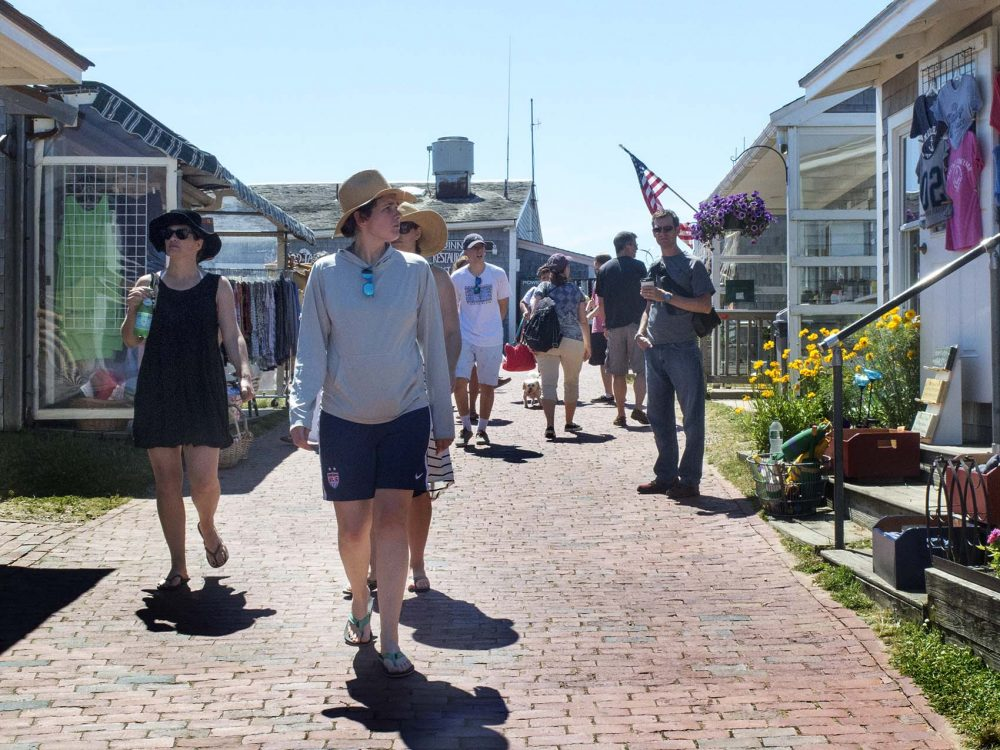 Tourists walk through the Shops at Aquinnah, part of the newly established Aquinnah Cultural District. (Andrea Shea/WBUR)