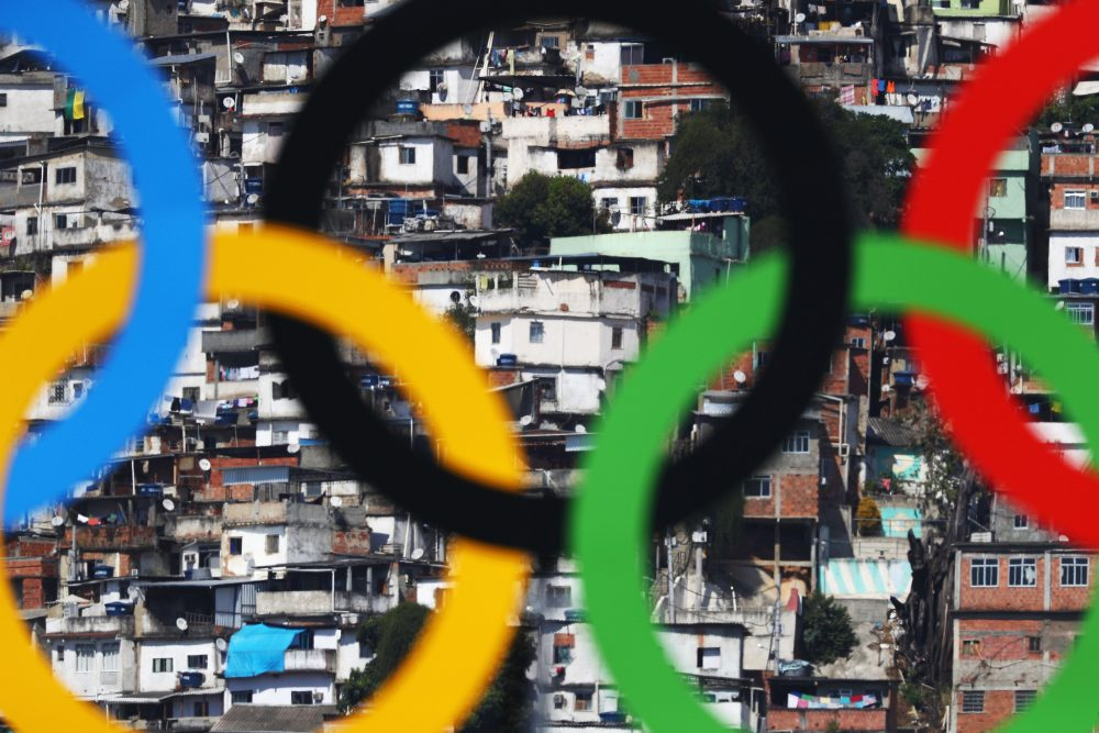 The Olympic Rings are seen with favelas in the background at the Sambodromo on Aug. 6, 2016 in Rio de Janeiro, Brazil. (Paul Gilham/Getty Images)