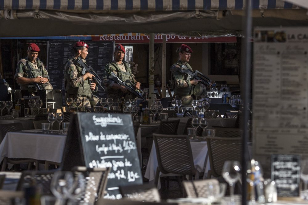 Soldiers walk through the old town past restaurants on Aug. 7, 2016 in Nice, France. (Dan Kitwood/Getty Images)