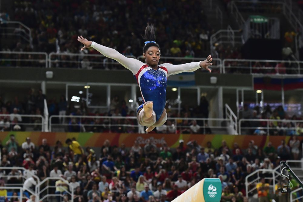 Simone Biles won gold in both the team and individual all-around. (Emmanuel Dunnand/AFP/Getty Images)