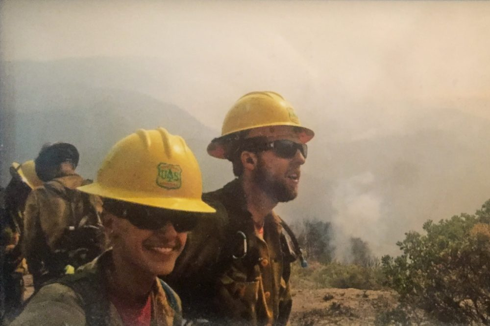 Z. Davidson (left) and her husband Matt Davidson in the field during a hotshot shift. Crews are scheduled 16-hour days for 14 days, but can be extended to 21 days during high need. (Annie Gilbertson/KPCC)