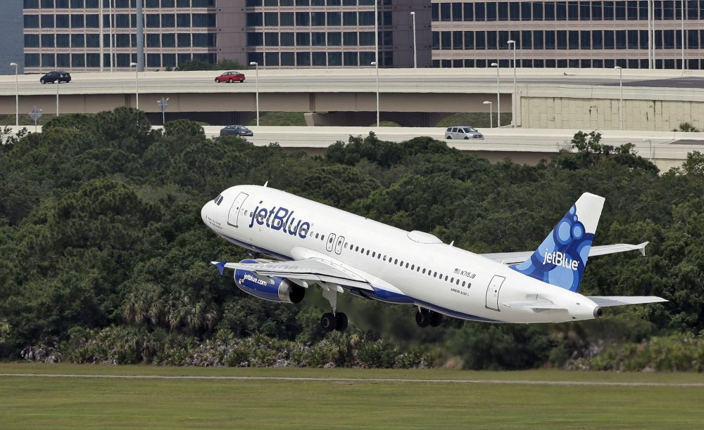 In this Thursday, May 15, 2014, file photo, a JetBlue Airways plane takes off from the Tampa International Airport in Tampa, Fla. (Chris O'Meara, File/AP)