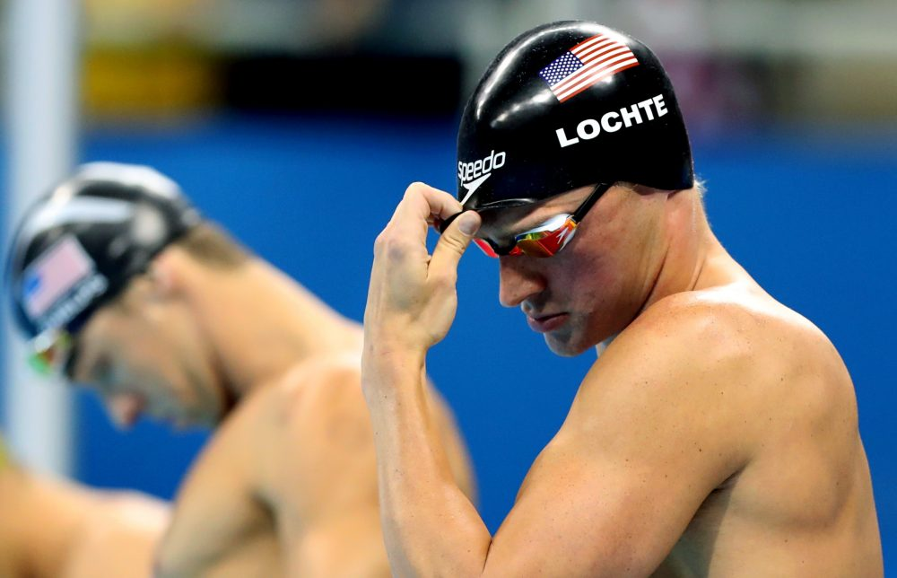 Ryan Lochte, right, and Michael Phelps prepares to compete in the final of the men's 200-meter individual medley during the swimming competitions in Rio. The USOC says Lochte and three other U.S. Olympians were robbed by armed men. (Lee Jin-man/AP)