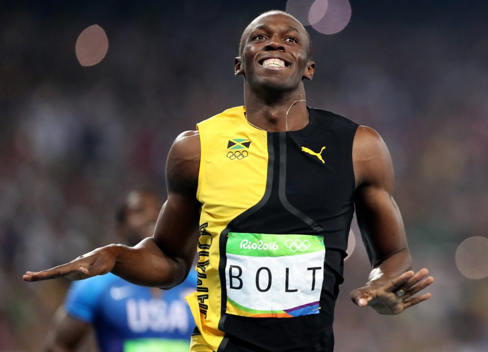 Jamaica's Usain Bolt celebrates as he crosses the finish line to win gold in the men's 100-meter on Sunday in Rio. (Lee Jin-man/AP)