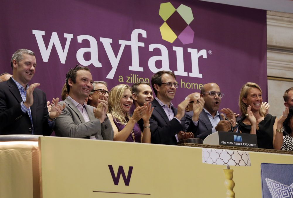 Steve Conine, third from right, and Niraj Shah, second from right, co-chairmen and co-founders of Boston home furnishings online retailer Wayfair, ring the New York Stock Exchange opening bell to mark their company's IPO. (Richard Drew/AP)