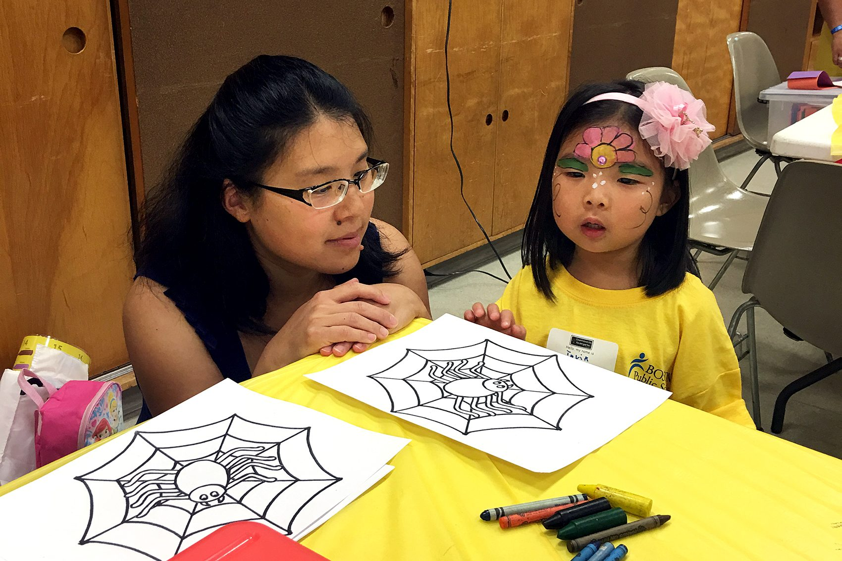 "Emily Wu and her 4-year-old daughter, Talia, are at a ""Countdown to Kindergarten"" party at the South Boston branch of the Boston Public Library. (Tonya Mosley/WBUR)"