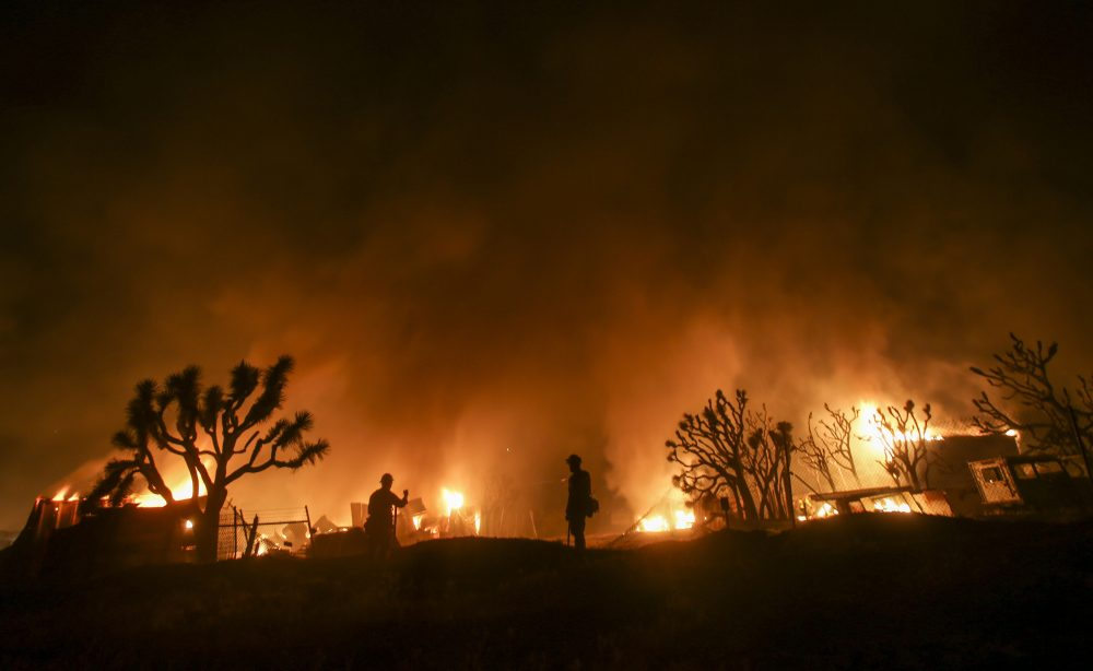 Firefighters watch the Blue Cut wildfire near Cajon Pass, north of San Bernardino, California on Aug. 16, 2016. (Ringo Chiu/AFP/Getty Images)