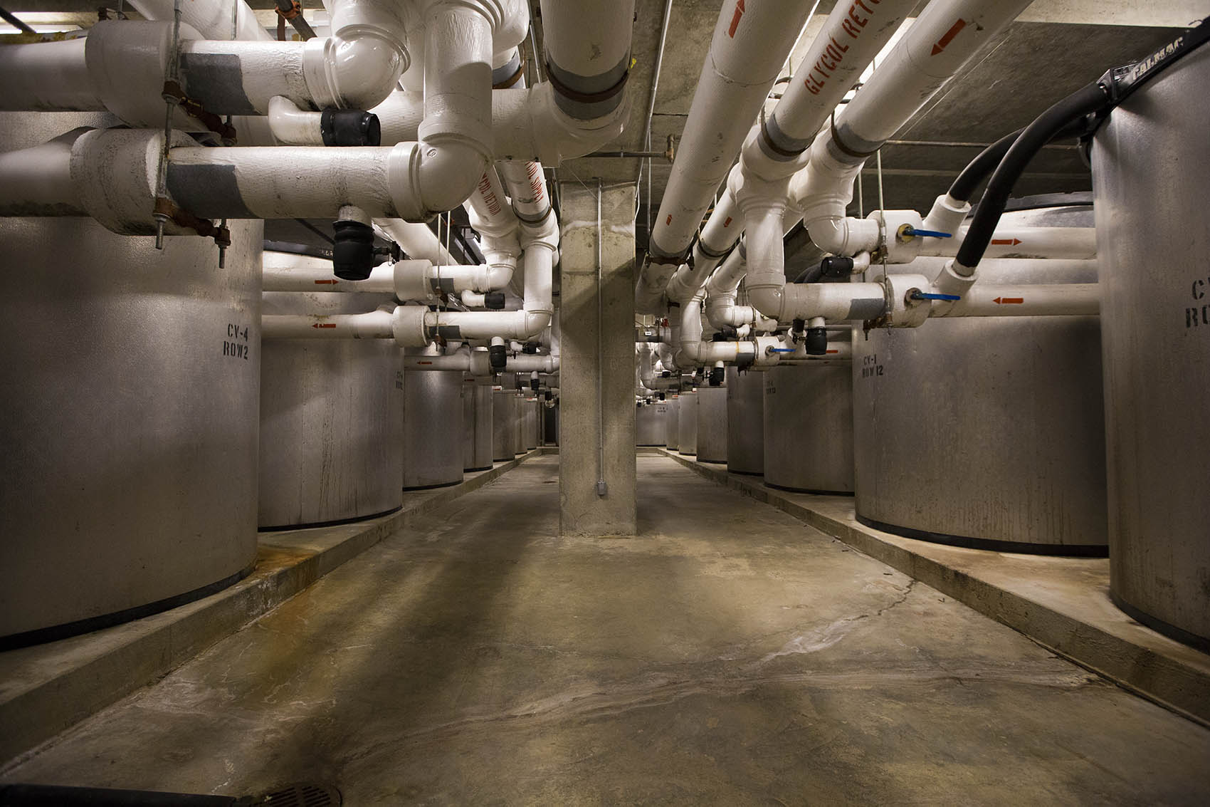 Sixty-five IceBank Energy Storage tanks in the basement of the Moakley Courthouse in Boston. (Jesse Costa/WBUR)