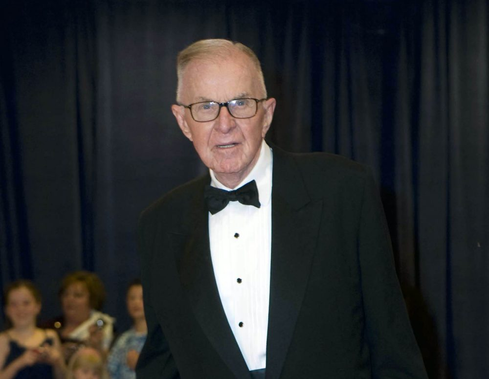 In this April 28, 2012, photo, John McLaughlin arrives at the White House Correspondents' Association Dinner on in Washington. McLaughlin, the conservative political commentator and host of the namesake long-running television show that pioneered hollering-heads discussions of Washington politics, died Tuesday, Aug. 16, 2016. He was 89. (Kevin Wolf/AP)