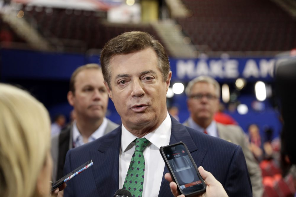 In this July 17, 2016 file photo, Trump Campaign Chairman Paul Manafort talks to reporters on the floor of the Republican National Convention at Quicken Loans Arena in Cleveland. (Matt Rourke/AP)