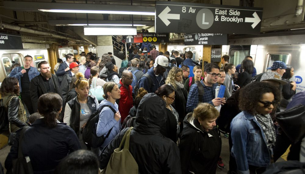 In this May 24, 2016, photo, L train commuters work their way across a crowded subway platform in New York. (Mark Lennihan/AP)