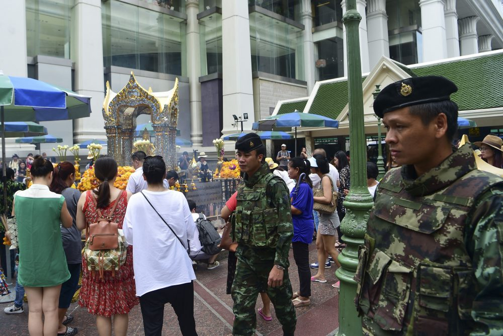 Thai soldiers patrol near the Erawan Shrine, a popular tourist landmark in Bangkok on Aug. 16, 2016, the eve of the first anniversary of a bomb attack that killed 20 people. (Munir Uz Zaman/AFP/Getty Images)