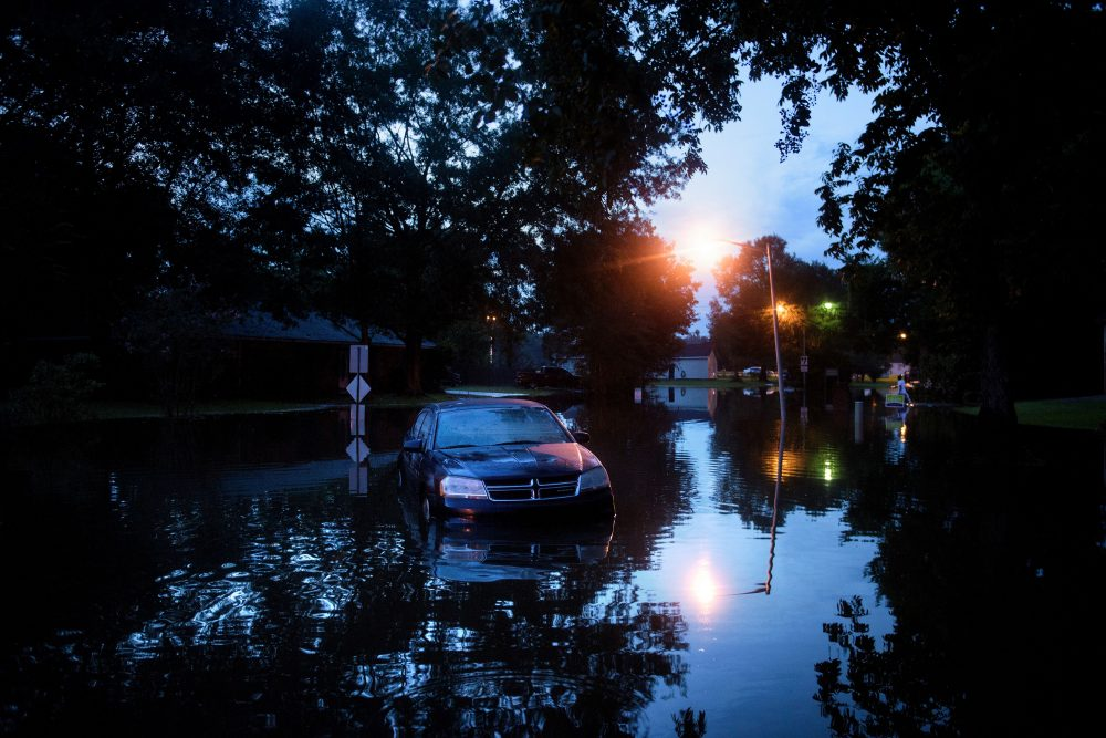 An abandoned car is seen in a flooded street on Aug. 15, 2016 in Baton Rouge, Louisiana. (Brendan Smialowski/AFP/Getty Images)