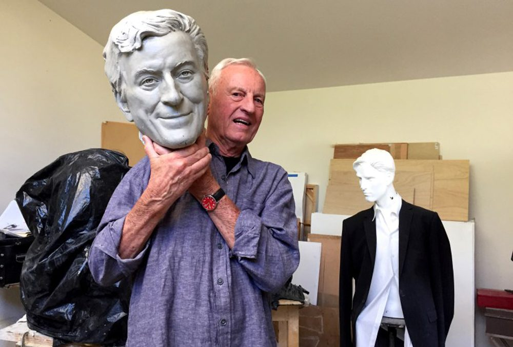 Sculptor Bruce Wolfe poses with the plaster cast of Tony Bennett's head. (Cy Musiker/KQED)