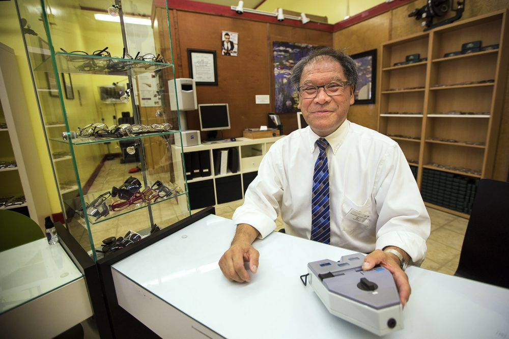 Professor Blair Wong sits in his optical shop, where students at the Benjamin Franklin Institute of Technology learn to become opticians and eye health technology professionals. (Jesse Costa/WBUR)