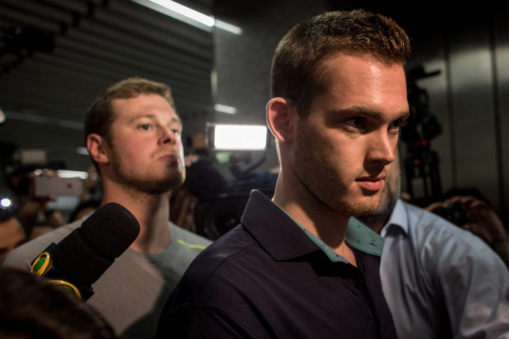 U.S Olympic swimmers Gunnar Bentz and Jack Conger leave the police headquarters at international departures of Rio de Janiero's Galeo International airport on Aug. 18, 2016 in Rio de Janiero, Brazil. (Chris McGrath/Getty Images)