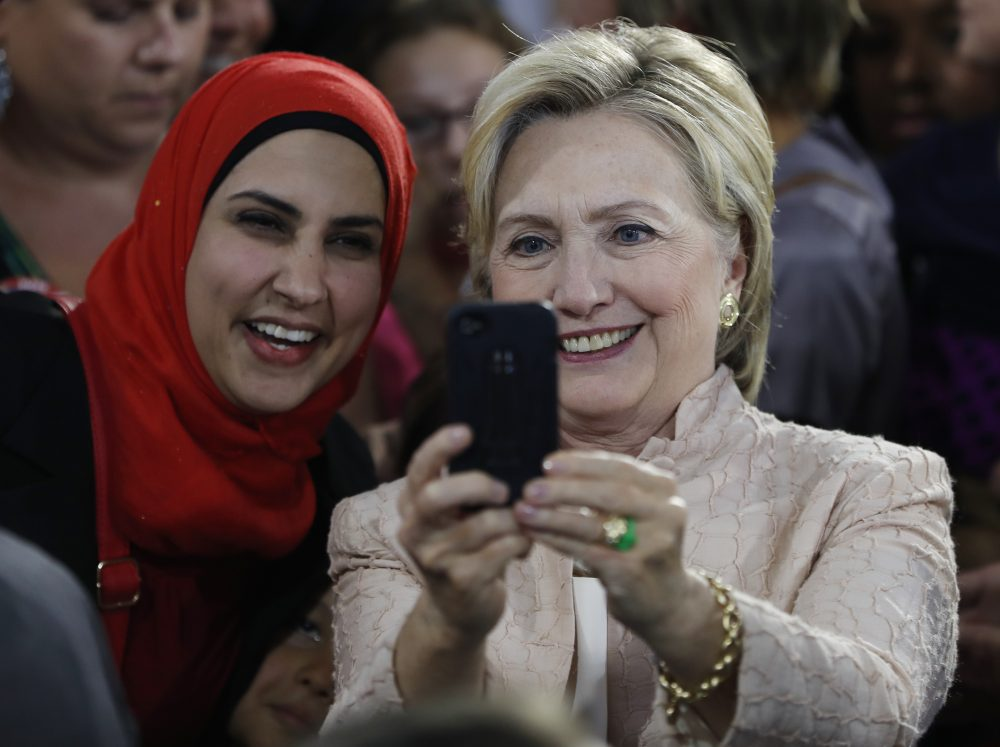 Democratic presidential candidate Hillary Clinton poses for a cell phone photo with a woman in the audience after speaking at campaign event at John Marshall High School in Cleveland, Wednesday, Aug. 17, 2016. (Carolyn Kaster/AP)