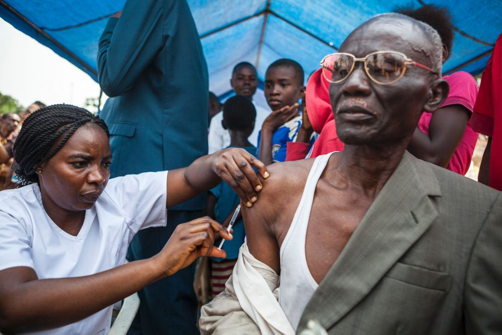 A man gets a yellow fever vaccine during a ceremony launching a response campaign against yellow fever in the district of Kisenso, Kinshasa, on July 20, 2016. (Eduardo Soteras/AFP/Getty Images)