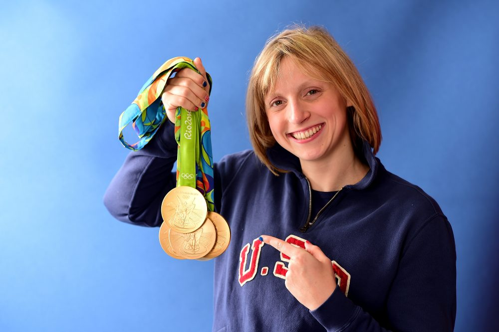 Katie Ledecky shows off her five medals -- four gold and one silver -- from the 2016 Rio Games. (Harry How/Getty Images)