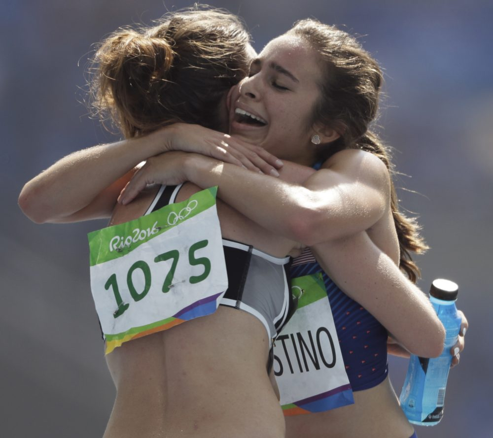 New Zealand's Nikki Hamblin, left, and United States' Abbey D'Agostino after competing in a women's 5000-meter heat during the athletics competitions of the 2016 Summer Olympics. (David J. Phillip/AP)
