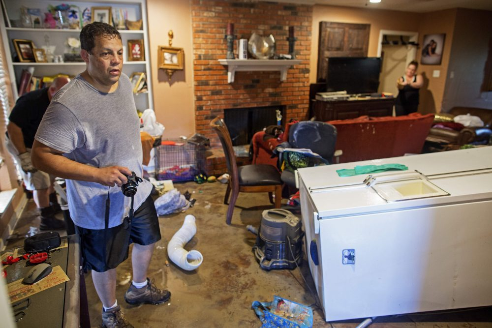 Raymond Lieteau takes photos his flood damaged home in Baton Rouge, La., Tuesday, Aug. 16, 2016. Lieteau had more than five feet of water in his home. (Max Becherer/AP)