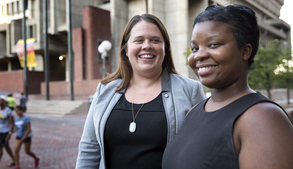 Megan Costello (left), Executive Director of the Mayor's Office of Women's Advancement, and Kristina Desir, Program Manager for AAUW Work Smart in Boston, near city hall. (Robin Lubbock/WBUR)