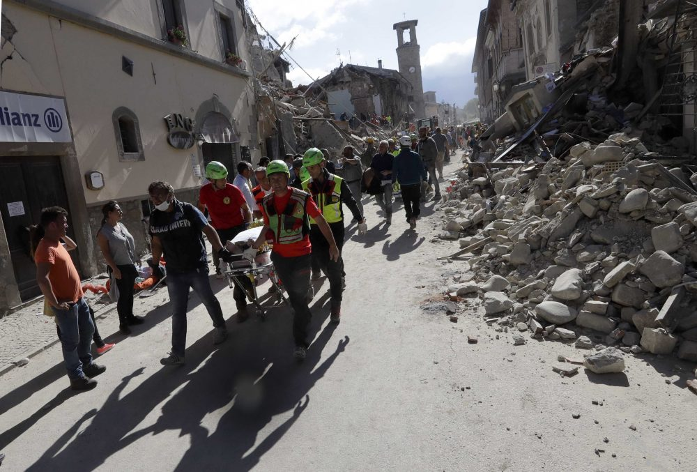 The body of a victim is pulled out of the rubble following an earthquake in Amatrice Italy on Wednesday. (Alessandra Tarantino/AP)
