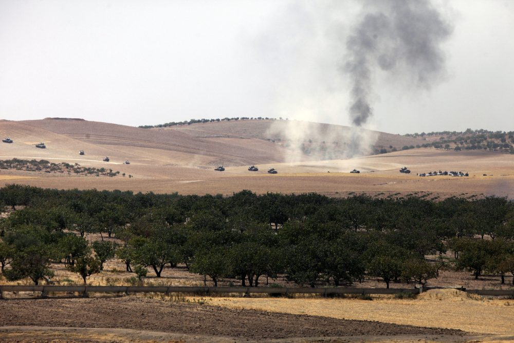 Turkish army tanks move toward the Syrian border as pictured from Karkamis, Turkey, Wednesday, Aug. 24, 2016. (AP)