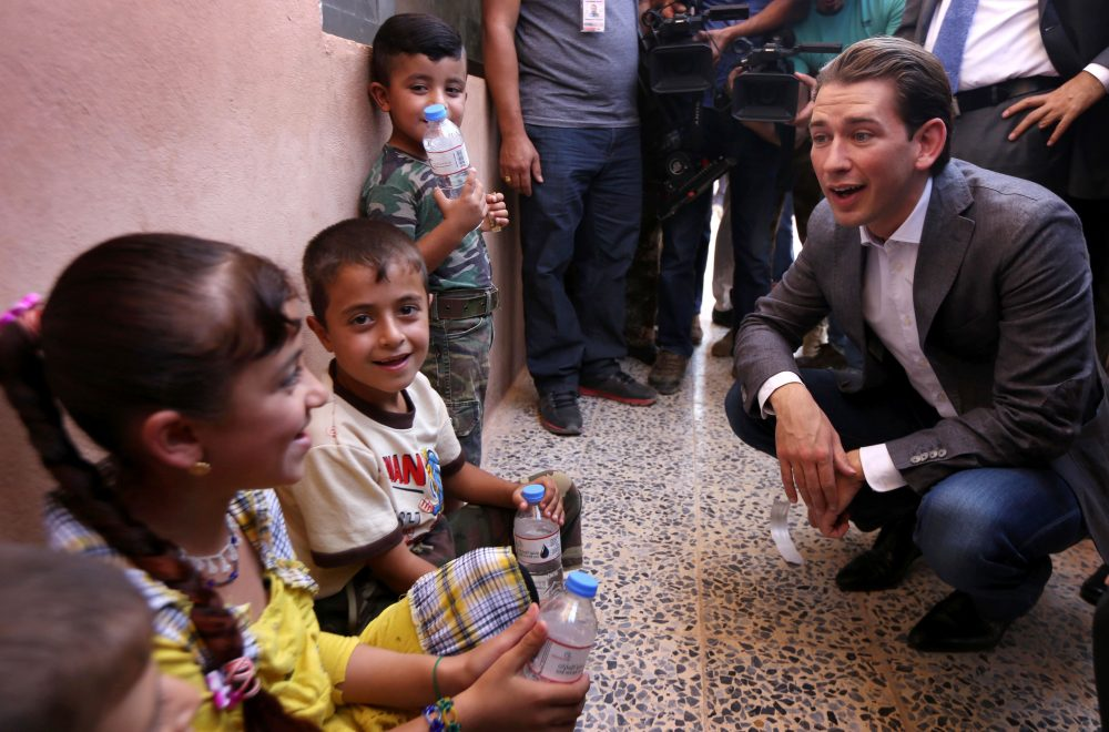 Austrian Foreign Minister Sebastian Kurz greets displaced Iraqi children, who fled with their families from violence in Mosul, during his visit to a camp in Makhmur, Iraq on July 16, 2016. (Safin Hamed/AFP/Getty Images)